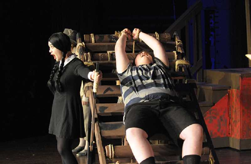 SETH GORDON - Wednesday (Hannah Sapitan) tortures her brother, Pugsley (Matt Goodbaudy), much to his delight.