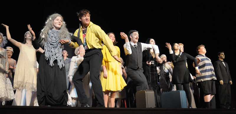 SETH GORDON - After being selected to be the showcase musical at the Oregon Thespians State Conference, the Newberg High School theater troupe performs 'The Addams Family' in front of approximately 1,300 fellow students April 6 at the Elsinore Theater in Salem.