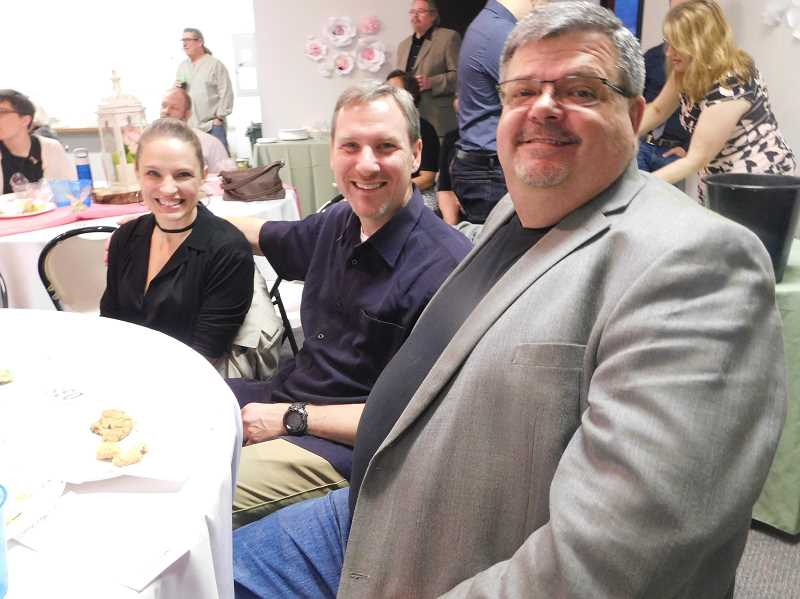 ESTACADA NEWS PHOTO: EMILY LINDSTRAND - Tamara Strobel, Paul Strobel and Rob Gaskill smile during the auction at the Estacada Chamber of Commerces Spring Gala last weekend.