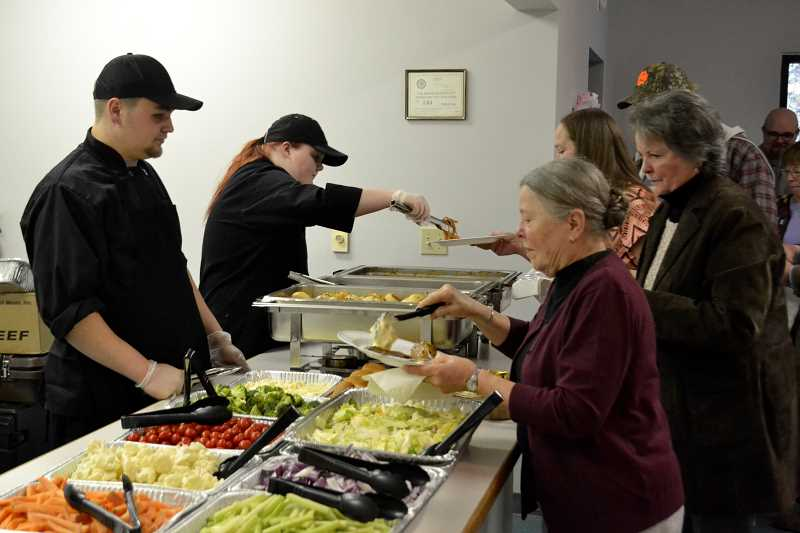 ESTACADA NEWS PHOTO: BRITTANY ALLEN - Culinary students serve attendees of the Estacada Chamber of Commerce Spring Gala.