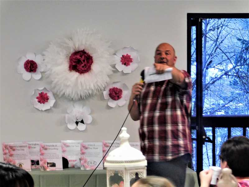 ESTACADA NEWS PHOTO: EMILY LINDSTRAND - Auctioneer Aaron Neldner points at a lucky winner during the Estacada Chamber of Commerces Spring Gala on Saturday, April 14.