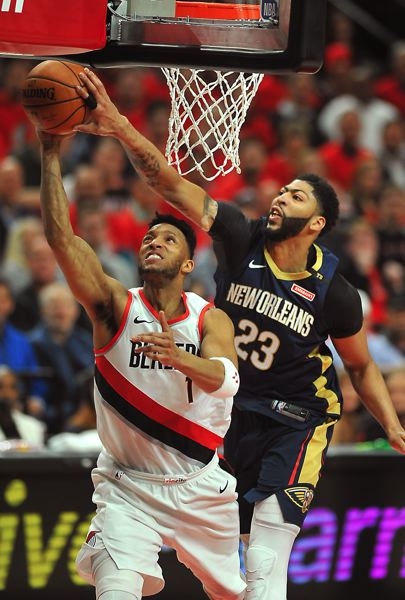 TRIBUNE PHOTO: VERN UYETAKE - New Orleans' Anthony Davis defends against the Trail Blazers' Evan Turner during Game 2 of their NBA playoff series Tuesday night at Moda Center.