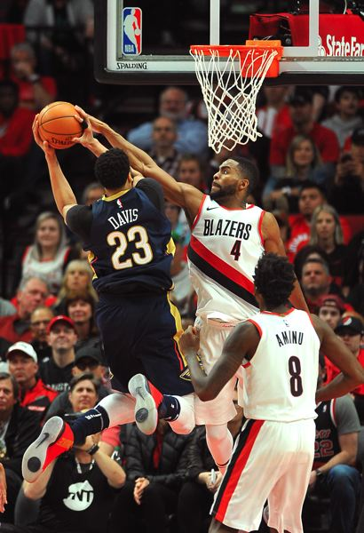 TRIBUNE PHOTO: VERN UYETAKE - Portland's Moe Harkless, back from an injury, checks Anthony Davis of New Orleans.