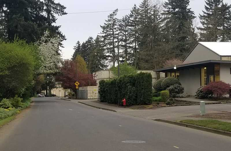 REVIEW PHOTO: GARY M. STEIN - Lake Oswego School Board members voted Monday to purchase the property at 6333 Lakeview Blvd. (right) for the district's new bus barn. This photo looks south on Lakeview; the intersection of Southwest 65th Avenue and McEwan Road is around the bend.