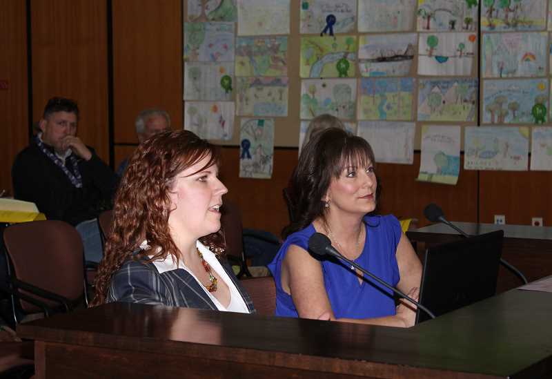 HOLLY GILL/MADRAS PIONEER - Sara Puddy, city human resources and administrative manager, and Lysa Vattimo, communications specialist for the city, review the results of of a citywide survey at the April 10 meeting of the Madras City Council.