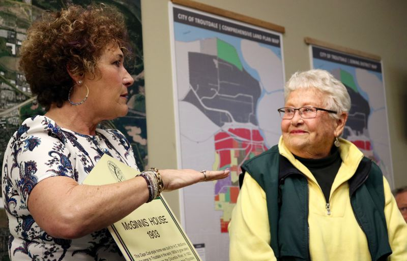 OUTLOOK PHOTO: ZANE SPARLING - Sharon Nesbit presented several historical markers to local homeowners during a Troutdale City Council meeting on Tuesday, April 10.