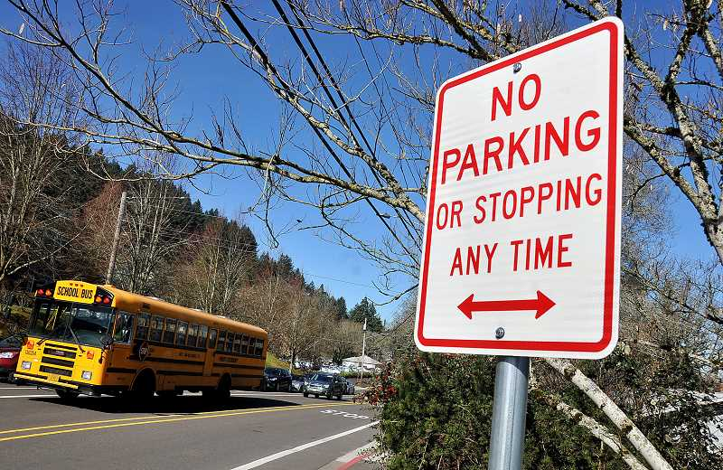 TIDINGS FILE PHOTO - School board members spent plenty of time listening to the City Council and residents about parking problems at West Linn High School, but they would not commit to taking action on what they saw as a City issue.