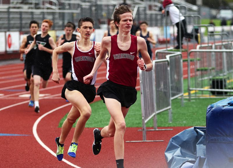 TIMES PHOTO: DAN BROOD - Sherwood High School junior Henry Giles (right) and sophomore Jaron Homer finished first and second in the 1,500-meter run during the meet against Tigard and Lake Oswego.