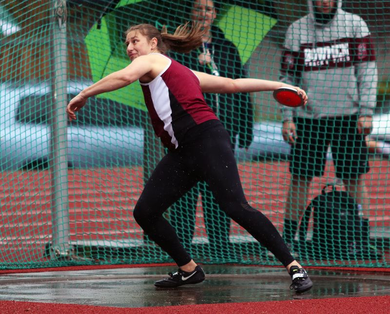 TIMES PHOTO: DAN BROOD - Sherwood High School senior Shelby Moran gets ready to let the discus fly during the Bowmens meet with Tigard and Lake Oswego.