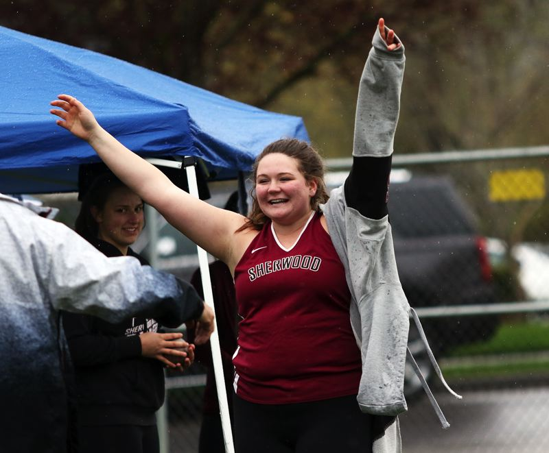 TIMES PHOTO: DAN BROOD - Sherwood High School senior Clair Johnson celebrates after breaking 40 feet in the shot put event during the Bowmens Three Rivers League double dual meet.