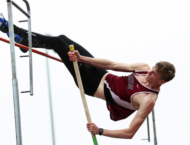 TIMES PHOTO: DAN BROOD - Sherwood High School senior Payton Churilla won the pole vault event during the Bowmens meet with Tigard and Lake Oswego.