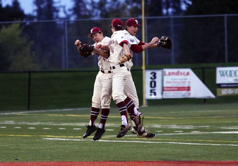 TIMES PHOTO: DAN BROOD - Tualatin outfielders (from left) Sean Chamberlin, Blake Jackson and Chris Freese celebrate following the Wolves 6-1 win over Sherwood on Saturday.