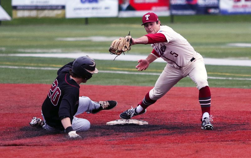 TIMES PHOTO: DAN BROOD - Tualatin junior shortstop Kyle Dernedde (right) makes the catch for the out at second base as Sherwood senior Riley Aggson slides to the bag.