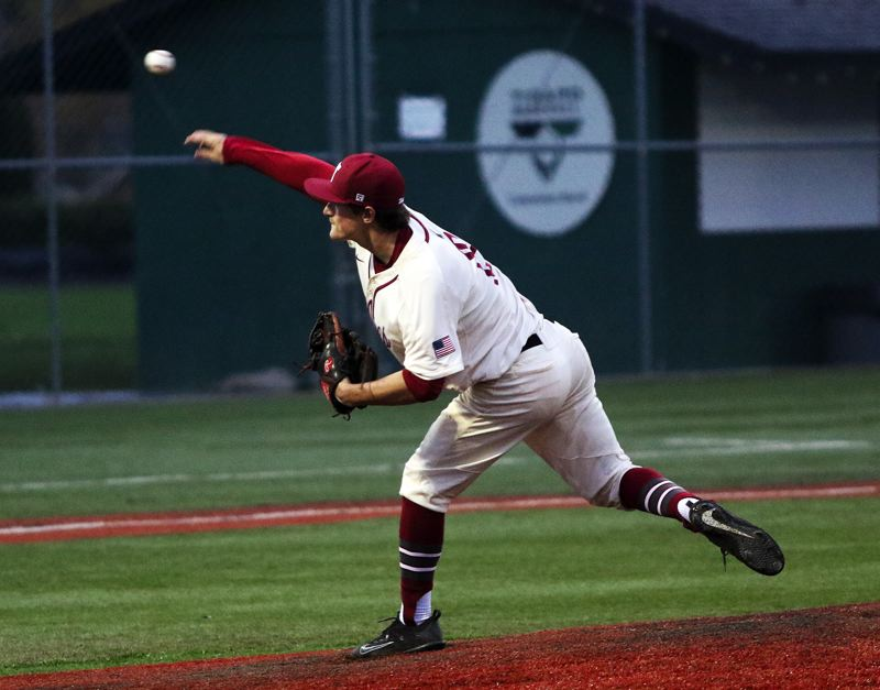 TIMES PHOTO: DAN BROOD - Tualatin senior Colby Jackson fires a pitch to the plate during the Wolves' 6-1 win over Sherwood.