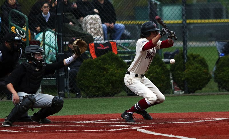 TIMES PHOTO: DAN BROOD - Tualatin senior Danny Shell puts down a bunt single during Saturday's game.