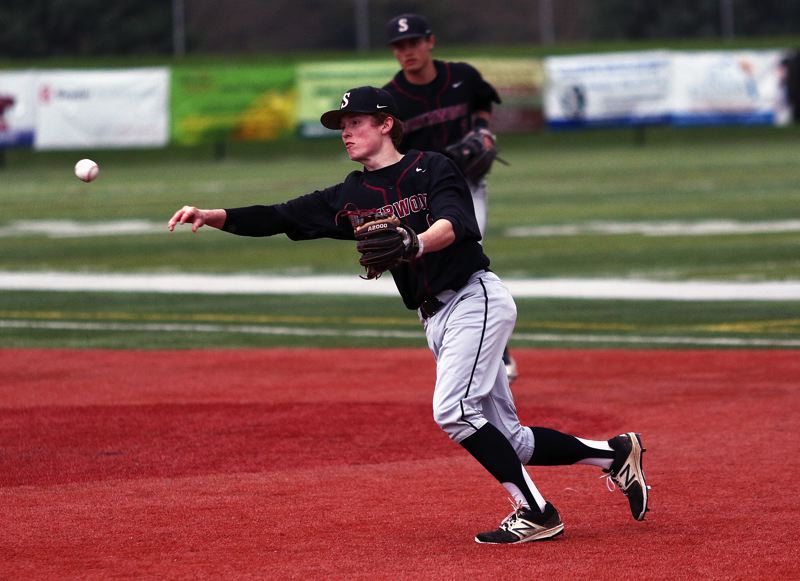 TIMES PHOTO: DAN BROOD - Sherwood second baseman Noah Beeks makes a throw to first base during the Bowmen's game with Tualatin on Saturday.