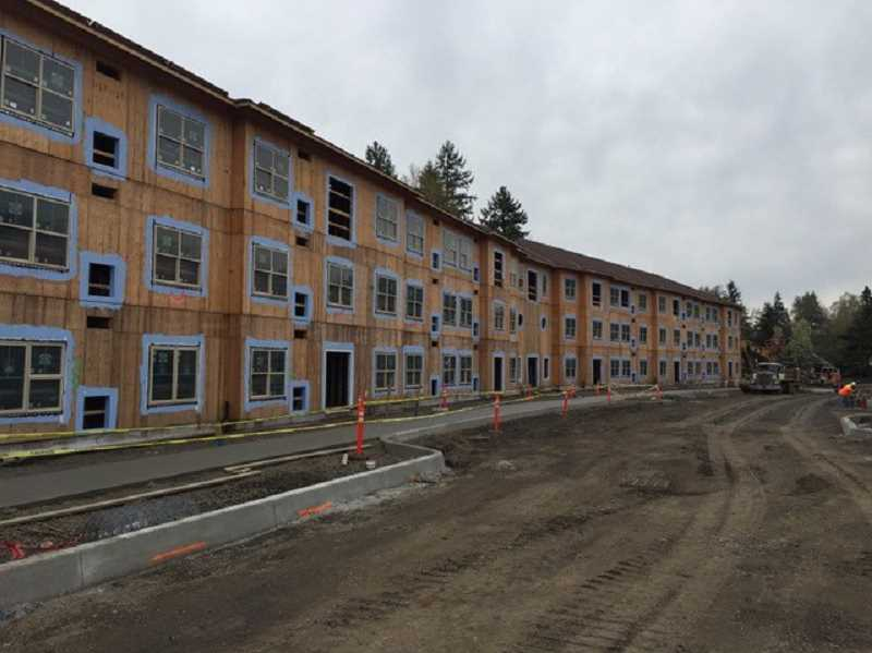 PHOTO COURTESY OF MARYS WOODS - Windows are being installed in the Collin residential building, one of three residential buildings expected to be open in December of this year.