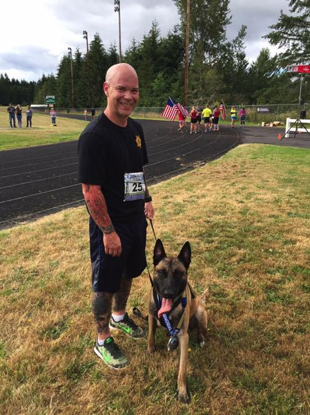 COLUMBIA COUNTY SHERIFFS OFFICE PHOTO - Dews pictured with Lars, the Sheriffs Office canine he handles.