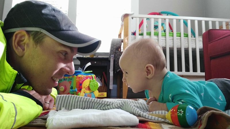 Ryan Vail spends some down time with his 4-month-old son Oliver during training leading up to this year's Boston Marathon.