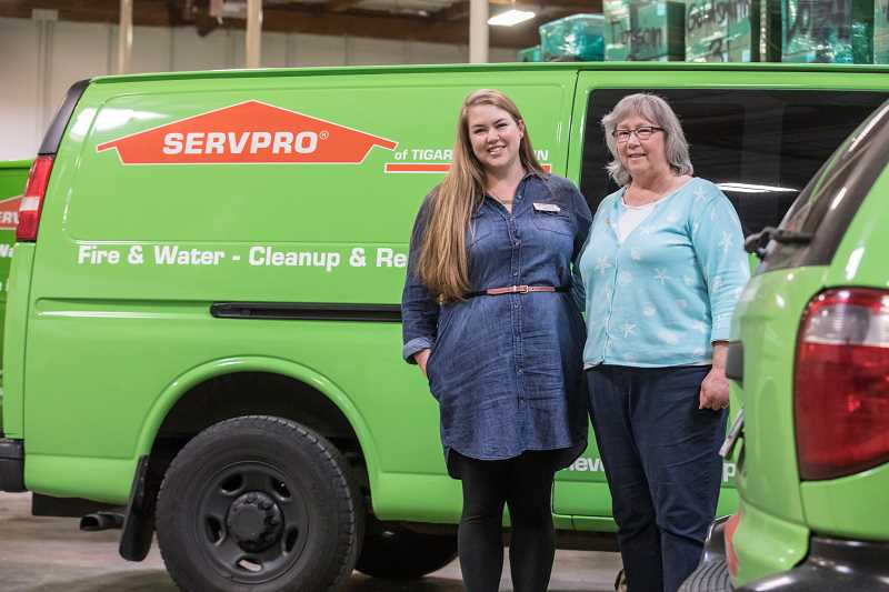 TIMES PHOTO: JONATHAN HOUSE - Tigard Servpro owner Kathy Linderman with her daughter Angie in their warehouse.
