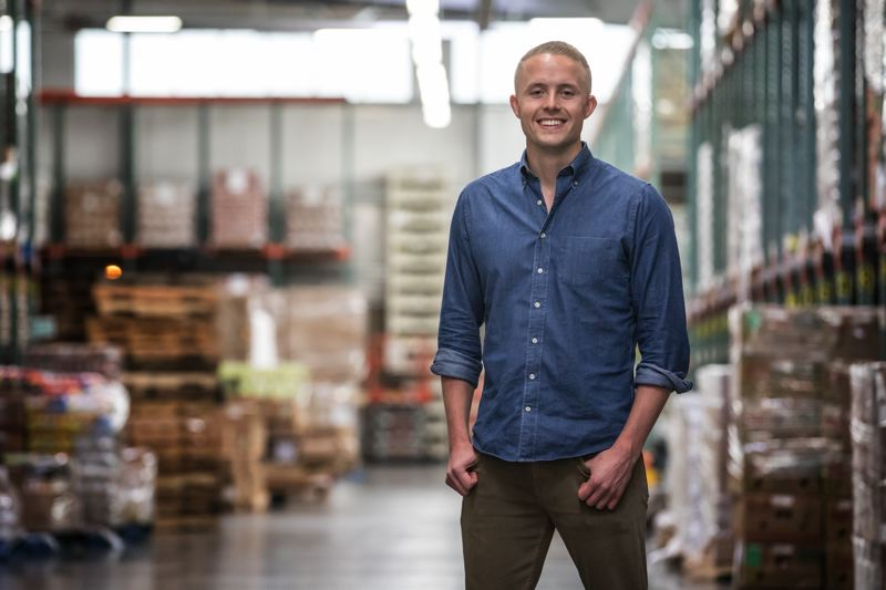 PAMPLIN MEDIA GROUP: JON HOUSE - WorkStep founder Dan Johnston at the Oregon Food Bank, where he and his team recently volunteered.