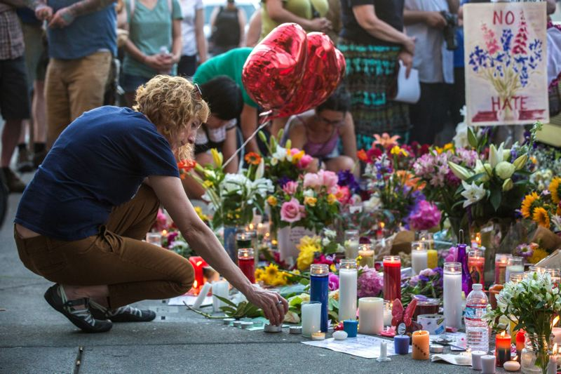 PAMPLIN MEDIA GROUP FILE PHOTO - Flowers, candles and chalk comments were part of a memorial that sprang up a year ago at the Hollywood Transit Center following the May 26, 2017, brutal attack that killed two men and seriously wounded another.