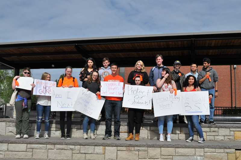 GAZETTE PHOTO: BLAIR STENVICK - Students wore orange to support stricter gun control legislation on Friday.