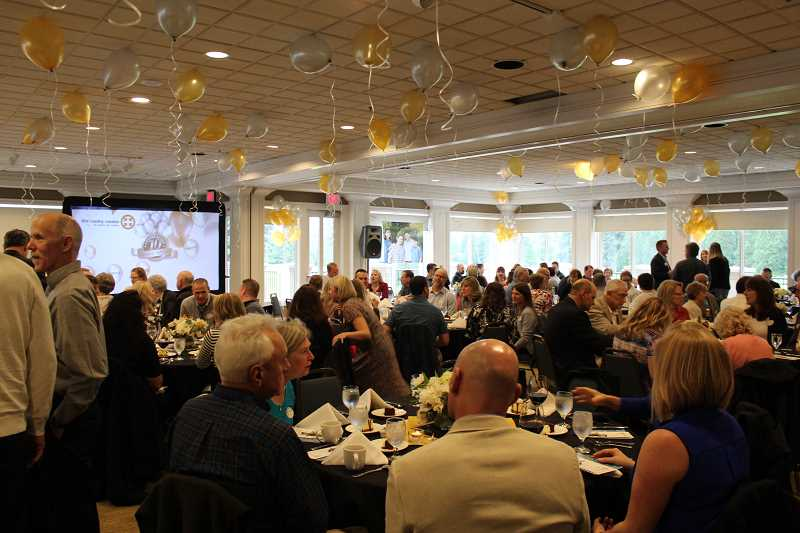 HERALD PHOTO: KRISTEN WOHLERS - Hundreds gathered at Willamette Valley Country Club on April 13 to celebrate the Canby Center's 10 years.
