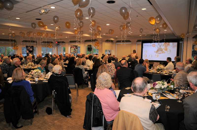 PHOTO BY MARK DERRY - Camille Hall (at the podium) shared her story with hundreds of people at Willamette Valley Country Club on April 13 for the Canby Center's 10 year anniversary fundraiser.