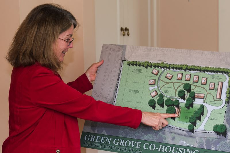 STAFF PHOTO: CHRISTOPHER OERTELL - Linda Taylor shows off a site plan for the Green Grove Cohousing Community in Forest Grove, which she hopes will include nine new single-family houses once it is complete.