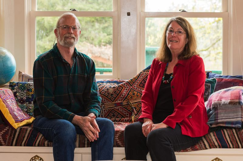 STAFF PHOTO: CHRISTOPHER OERTELL - Brad and Linda Taylor sit in the family room in their home, which will be turned into a community house for residents of the Green Grove Cohousing Community in Forest Grove.
