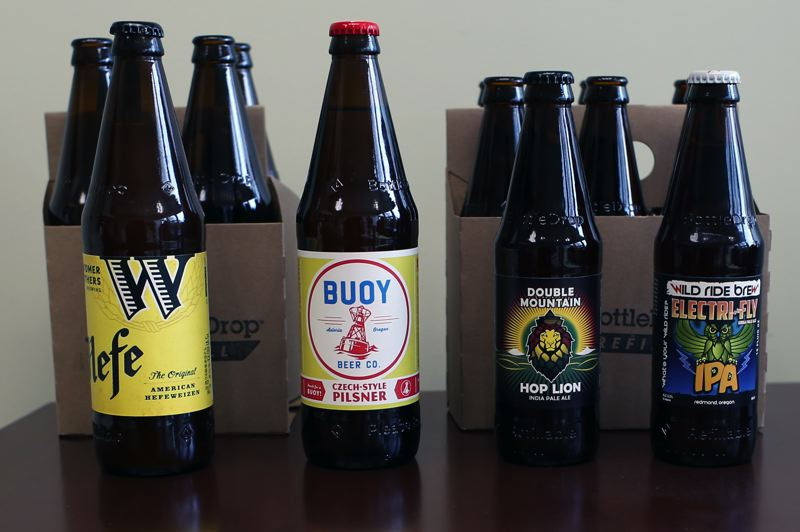 JESSIE DARLAND - These four local beers will be bottled in the new refillable beer bottle beginning this July. Bottles are embossed with 'refillable' to be easily distinguishable from other bottles.
