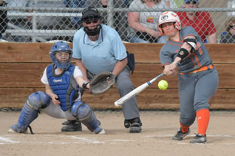 LON AUSTIN/CENTRAL OREGONIAN - Laila Bennett drives the ball to left field. Bennett had a home run and a double as the Gladstone Gladiators defeated the Crook County Cowgirls 8-1 Friday afternoon in Prineville.