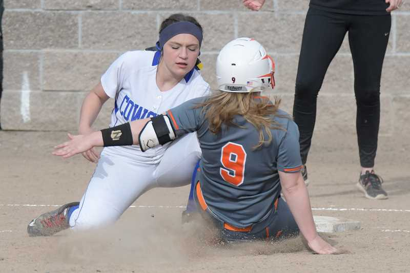LON AUSTIN/CENTRAL OREGONIAN - Crook County's Justin Brinkley tags Gladstone's Laila Bennett out at third.