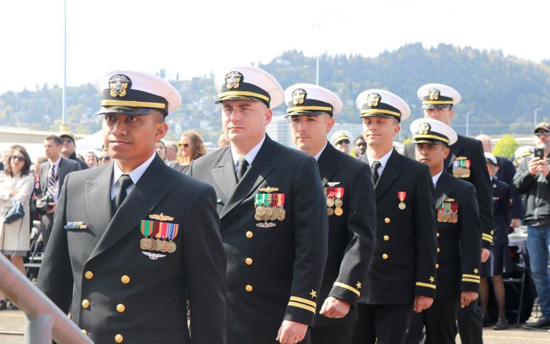 TRIBUNE PHOTO: ZANE SPARLING - Hundreds of sailors hustled onboard the USS Portland on Saturday, April 21 during a commissioning ceremony at the Port of Portland's Terminal 2.