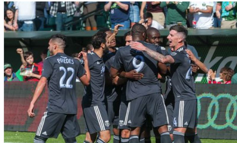 TRIBUNE PHOTO: DIEGO G. DIAZ - The Timbers celebrate after Larry Mabiala's goal Sunday against New York City.