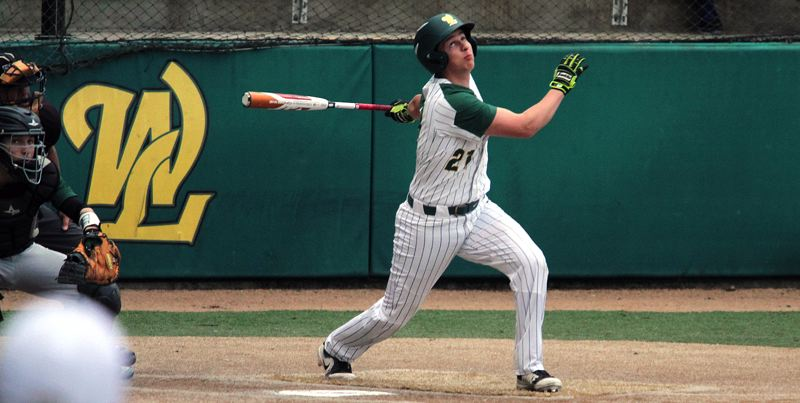 TIDINGS PHOTO: MILES VANCE - West Linn senior Zach Bell homored during his team's 5-4 loss to Tigard at West Linn High School on Friday.