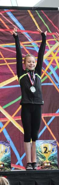 SUBMITTED PHOTO - Piper Colby poses with her medals after a gymnastics meet. The Wilsonville teen placed sixth all-around in her age group. on April 14.
