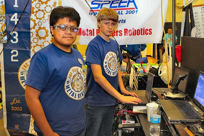 DAVID F. ASHTON - In their pit area, the Metal Beavers Team Captain and driver JR Surban checked their robots programming with the co-driver, home-schooled student Jacob Purvis.