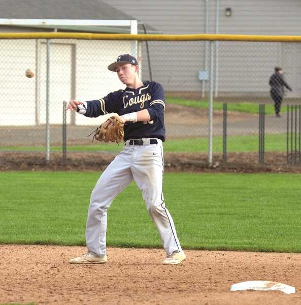 HERALD PHOTO: TANNER RUSS - In four at bats, Canby senior Alec Hopkins had three hits, two RBIs, and one run in Canby's first game against the visiting Lakeridge Pacers. Hopkins also had a diving save late in the game to help close the show.