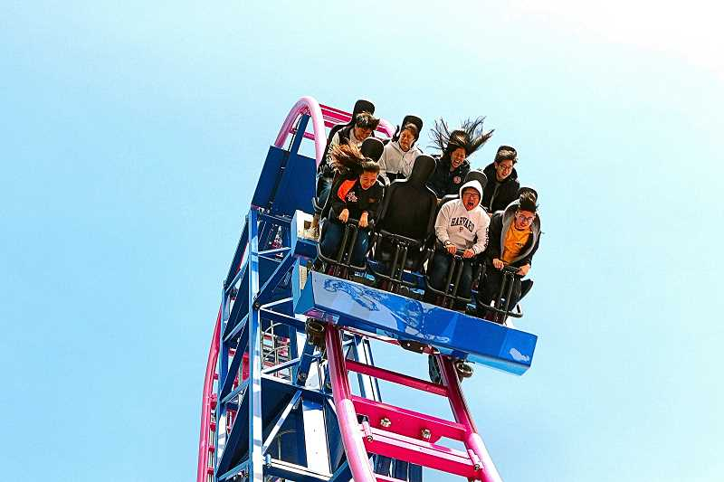 DAVID F. ASHTON - Cresting the 72-foot first drop, these riders on the new Oaks Park Adrenaline Peak roller coaster look thrilled already. Or is that fear.