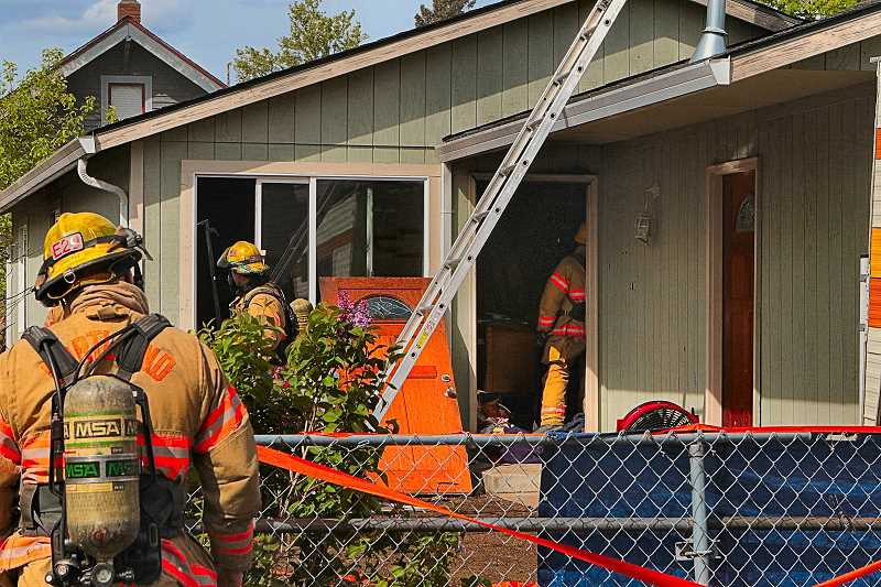 DAVID F. ASHTON - Firefighters quickly extinguish a fire in the kitchen of this house, reportedly related to a camp stove found there.