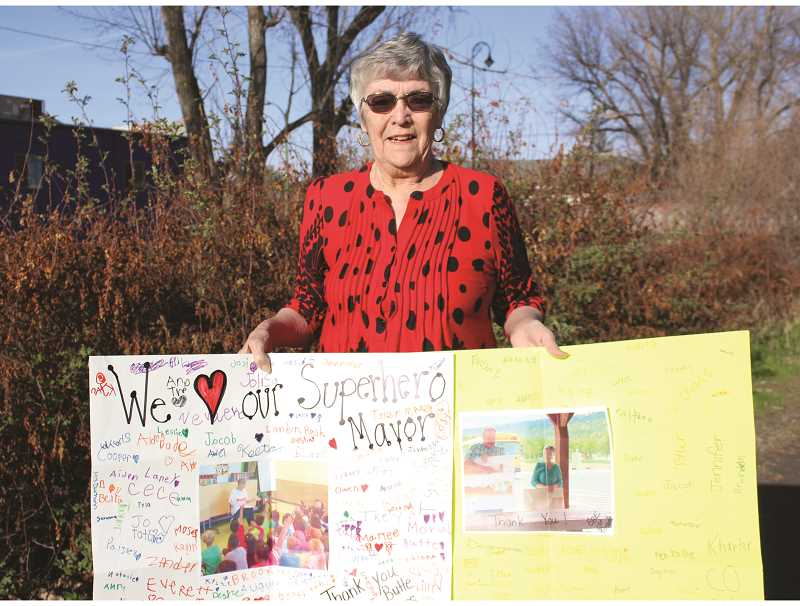JASON CHANEY/CENTRAL OREGONIAN  - Betty Roppe proudly displays a poster made for her by the Barnes Butte Elementary students honoring her work. The longtime mayor and community activist was also recently presented a Lifetime Achievement award by the Prineville-Crook County Chamber of Commerce. Roppe says she doesn't plan on running for mayor again at the end of her current term, but she does play to stay active in the community.