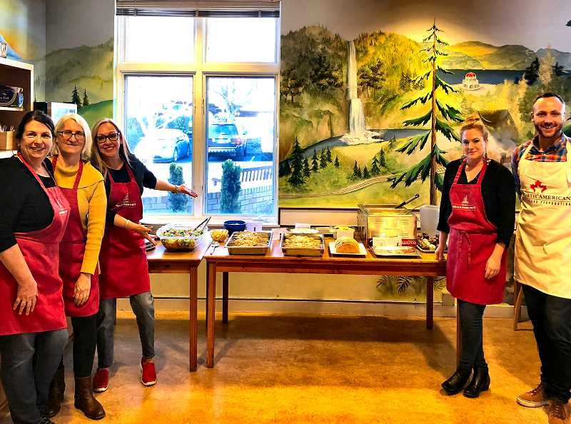 Shown, from left, are some of the John L. Scott Woodstock agents who prepared dinner on March 20 at the Legacy Emmanual Ronald McDonald house: Georgia Sohlstrom, Amanda Schueler, Michelle Maida, Angel Drinkwine, and Alex Roy.