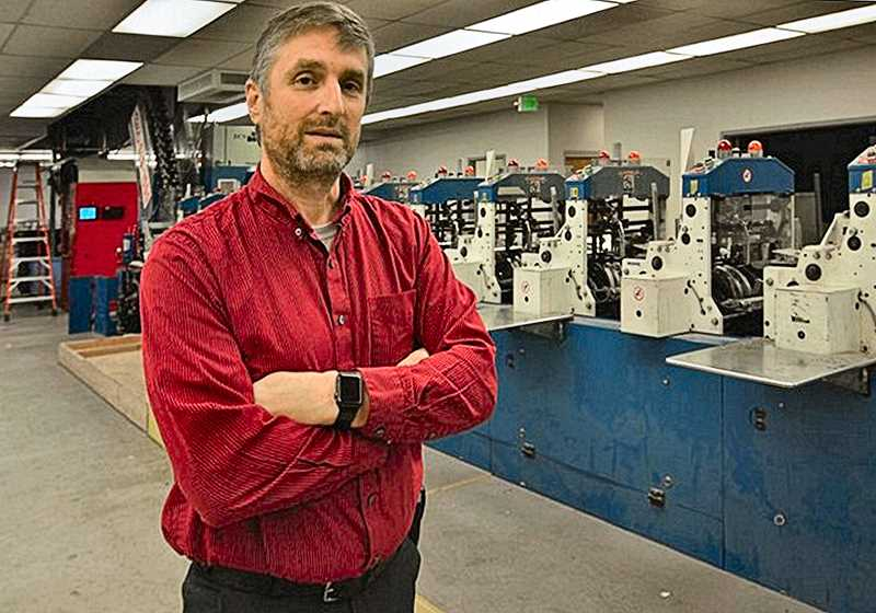 VERN UYETAKE - Don Atwell, General Manager of Printing Operations for Pamplin Media Group, shows off new equipment at our Gresham print facility that significantly increases efficiency, and the capacity to insert advertising supplements and coupons.