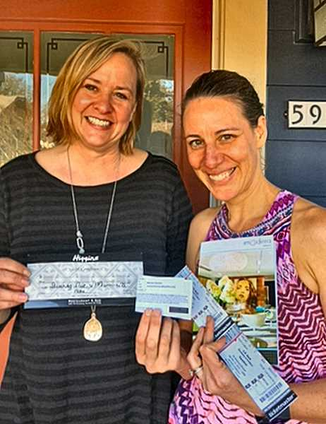Hamilton Tickets winner in the Llewellyn Elementary School raffle was (at right) Monica Bastian, a Sellwood resident and a Duniway parent. Making the presentation was Erika Morales, 2018 Auction Chair.
