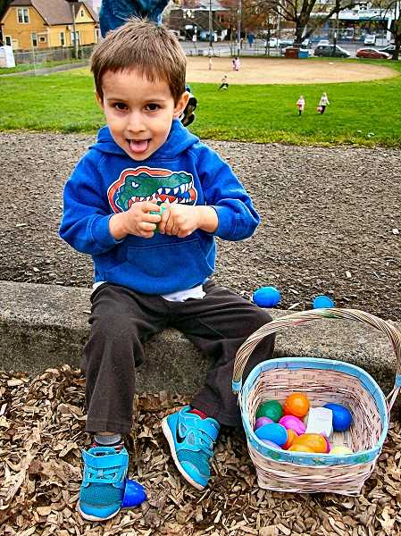 RITA A. LEONARD - Rocco, age 5, counts up his Easter loot in Brooklyn Park.