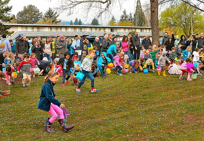DAVID F. ASHTON - Kids were eagerly poised at the start of the SMILE Easter Egg Hunt - and then the signal was given and they were off, scooping up candy in Westmoreland Park.