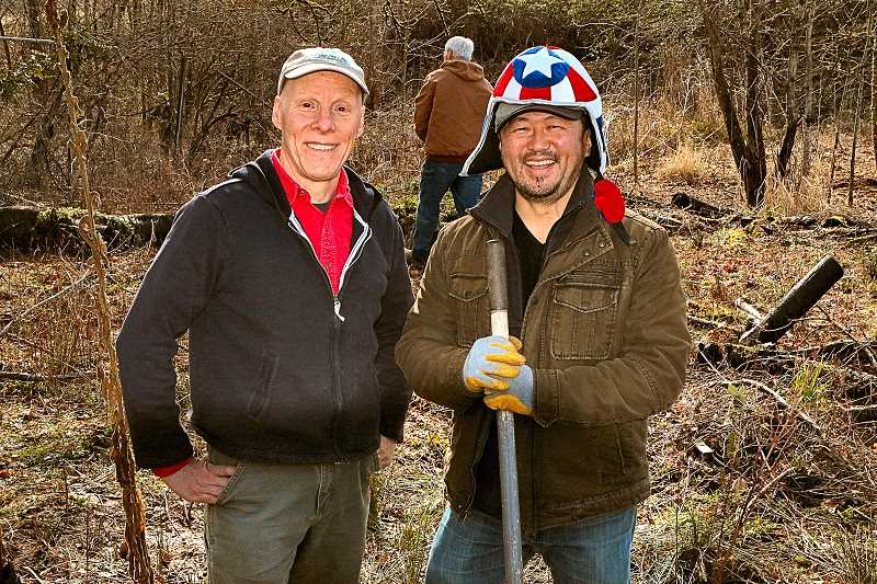 DAVID F. ASHTON - JCWC Executive Director Daniel Newberry, personally thanking superhero Captain America for coming out to pull invasive weeds and clean up Crystal Springs Creek near Westmoreland Union Manor.