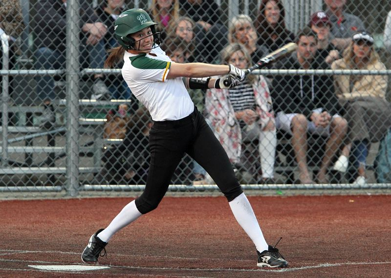 TIDINGS PHOTO: MILES VANCE - West Linn senior Kaitlin Lampson stepped up with four hits, two RBIs and four runs in her team's 21-11 five-inning win over Newberg at Rosemont Ridge Middle School on Monday.